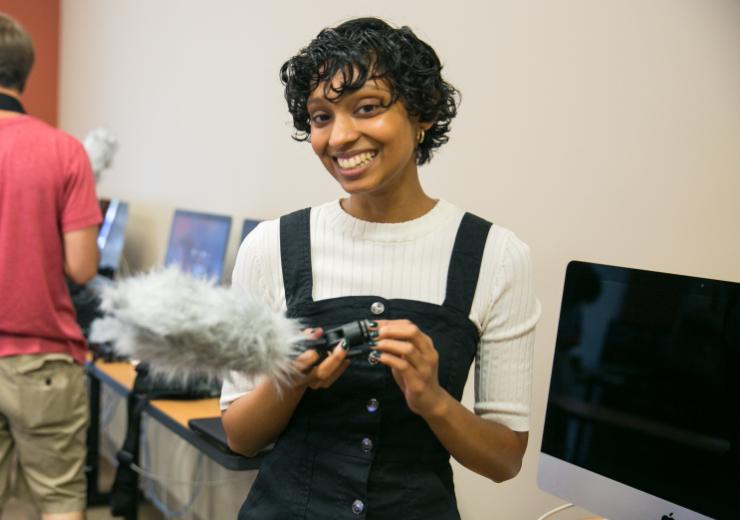 Student holds camera